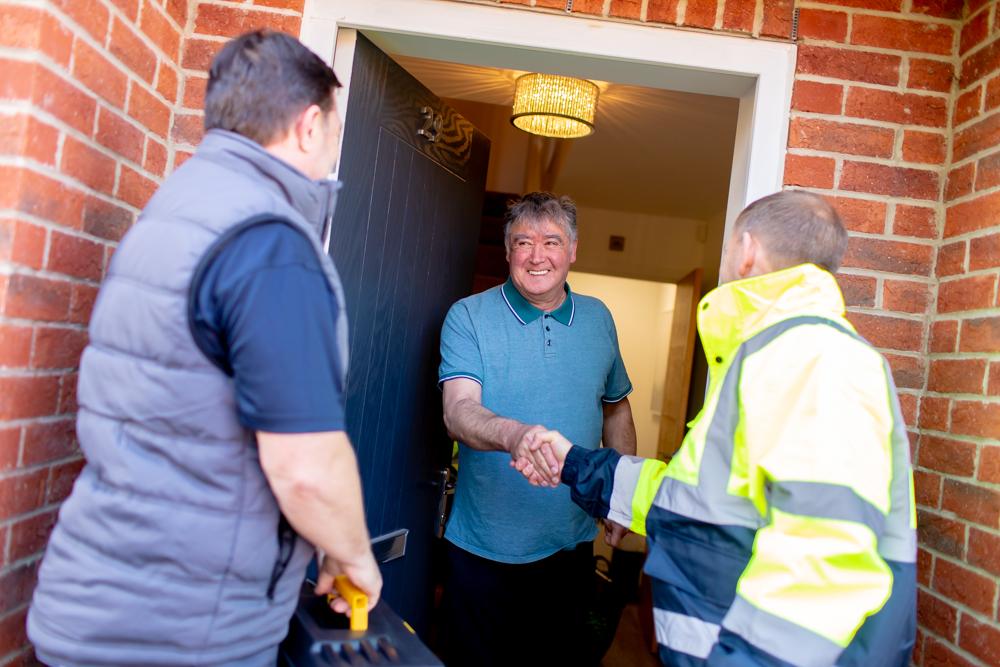 Livv Housing team meeting customer at front door