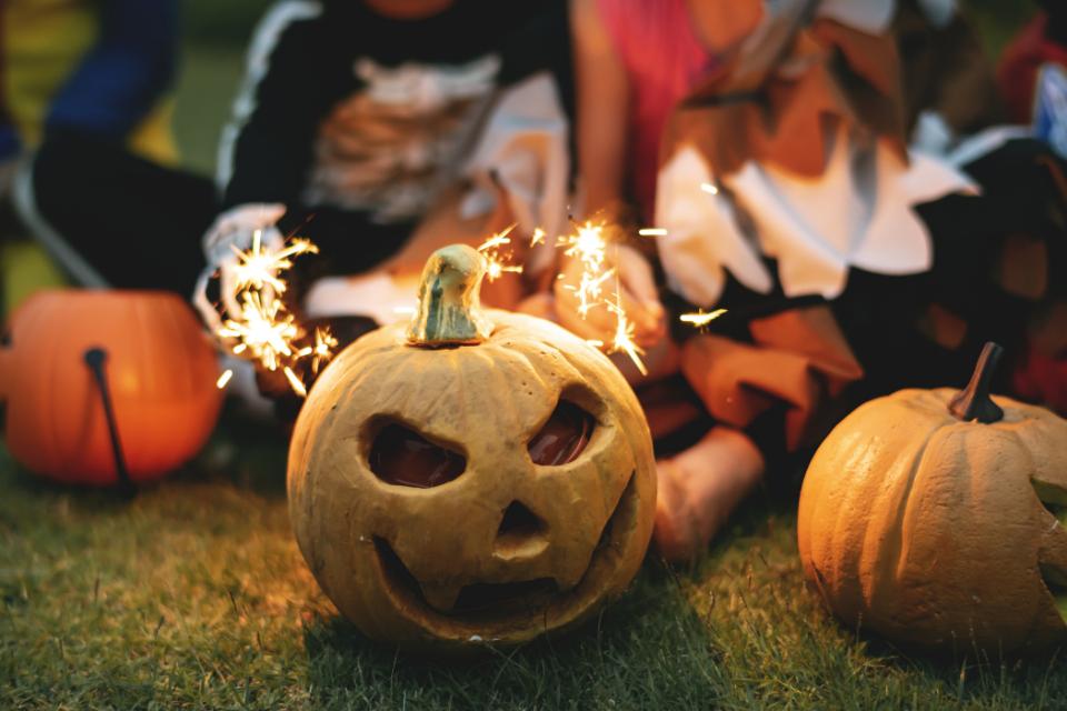 kids playing around pumpkins